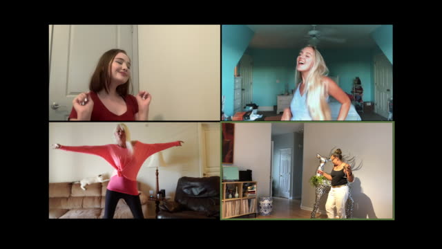 four young and mature women dance together while video chatting - dancing stock videos & royalty-free footage