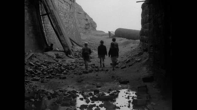 four young boys walking through derelict uk factory site; 1956 - ruined stock videos & royalty-free footage
