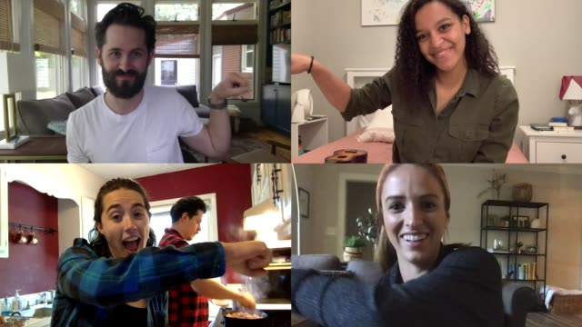 four young millennial friends fist bump and smile during a video call from their homes - boyfriend stock videos & royalty-free footage