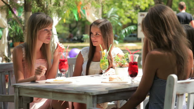 four young woman in summer outdoors sidewalk cafe - four people stock videos & royalty-free footage