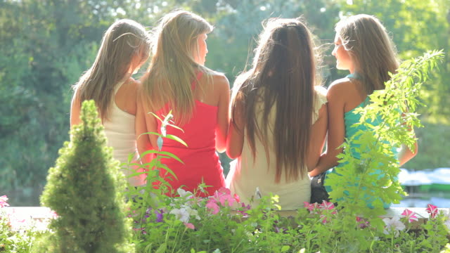 Four young woman in summer park