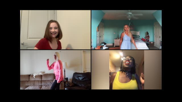 four young women dance along to their favorite song via video call. - home interior stock videos & royalty-free footage