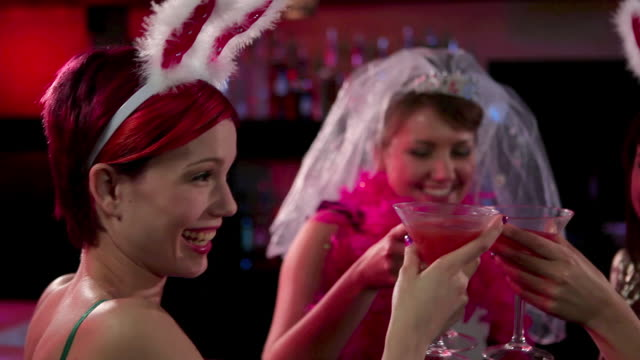 vídeos de stock, filmes e b-roll de four young women on hen night - despedida de solteira