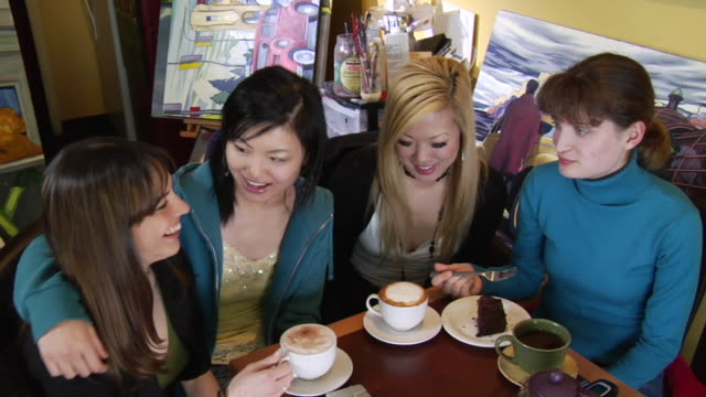 ha ms four young women sitting in coffee shop, eating chocolate cake and drinking cappuccino/ vancouver, bc - kelly mason videos stock videos & royalty-free footage