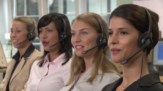 vídeos y material grabado en eventos de stock de cu, four young women with headset working in call center, portrait - call center latino