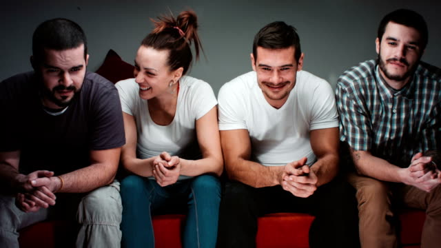 Four Young Young People Watching TV