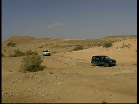 four-by-fours on dust road, negev desert, israel - negev stock videos & royalty-free footage