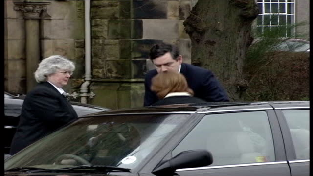 four-month-old son of gordon brown diagnosed with cystic fibrosis; tx 11.1.2002 kircaldy: brown helps his wife sarah from car on arrival at church... - cystic fibrosis stock videos & royalty-free footage
