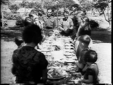 fourteen sons and six daughters of family pose in front of farmhouse / joseph and lazaria marquis pose in front of garden / two men hammering fence... - milk churn stock videos & royalty-free footage