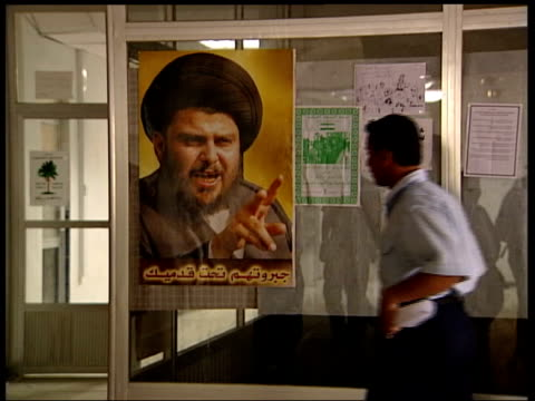 fourteen us marines killed in roadside attack tx basra picture of moqtada alsadr on window iraqi policeman walks up to poster kisses it and gives... - muqtada al sadr stock videos & royalty-free footage