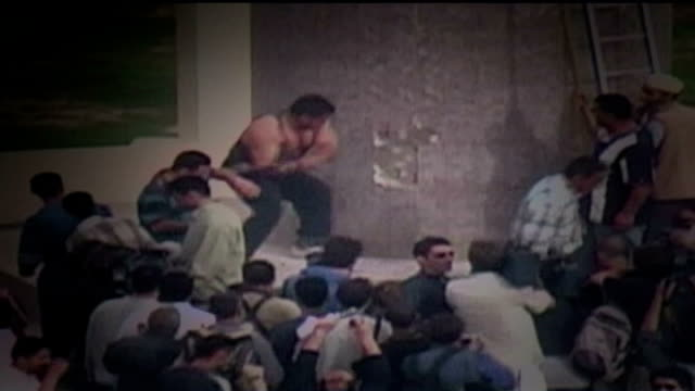 fourth anniversary of operation iraqi freedom graphicised sequence of the toppling of saddam hussein statue in firdos square showing kazim al jubouri... - saddam hussein stock videos & royalty-free footage