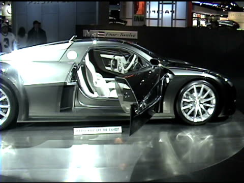 stockvideo's en b-roll-footage met ws of me fourtwelve midengine concept sports car revolving on turntable / cu floor sign / ws driver side profile / ms dashboard and steering wheel /... - chrysler