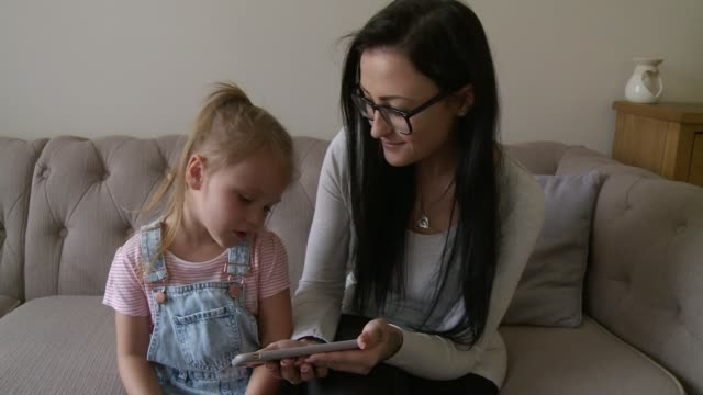 fouryearold girl praised for 'saving mother's life' by calling 999 after fall england county durham consett int mila dobby setup sitting on sofa with... - county durham england stock videos & royalty-free footage