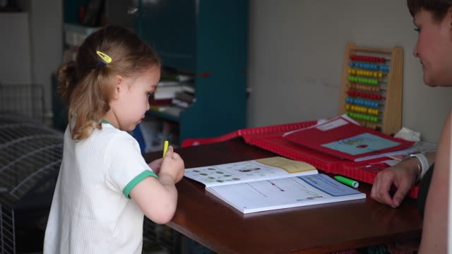 four-year-old lois copley-jones who is the photographer's daughter, does school work on the third day of the nationwide school closures on march 25,... - working from home stock videos & royalty-free footage