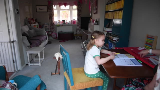 fouryearold lois copleyjones who is the photographer's daughter does school work on the third day of the nationwide school closures on march 25 2020... - homework stock videos & royalty-free footage