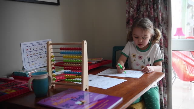 fouryearold lois copleyjones who is the photographer's daughter does school work on the third day of the nationwide school closures on march 25 2020... - studying stock videos & royalty-free footage