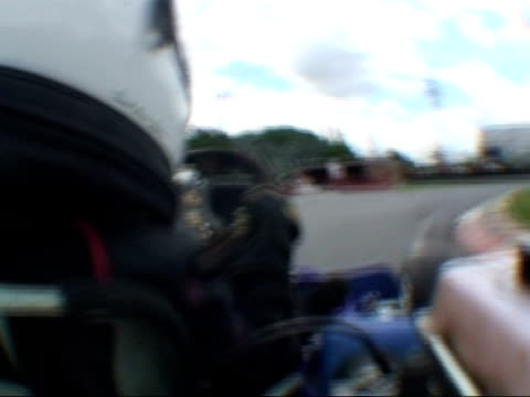 Fouryearold signs gokart racing contract Reporter to camera PAN gokart as along and past shots from onboard gokart showing Ben Kasperczak as drives...