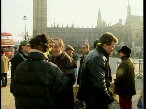 protests outside parliament; countryside alliance members outside parliament / members chatting / man with ferrit up sleeve of coat / anti-fox... - sleeve stock videos & royalty-free footage