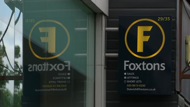 foxtons estate agents accused of over charging clients; dulwich: 'foxtons' sign on wall - dulwich stock videos & royalty-free footage