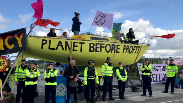 fracking activists block the entrance to the cuadrilla's fracking site on september 10 2019 near blackpool england extinction rebellion occupied the... - fossil fuel stock videos & royalty-free footage