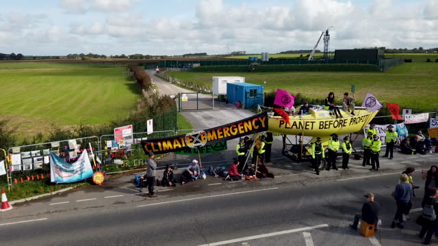 fracking activists block the entrance to the cuadrilla's fracking site on september 10, 2019 near blackpool, england. extinction rebellion occupied... - design element stock videos & royalty-free footage