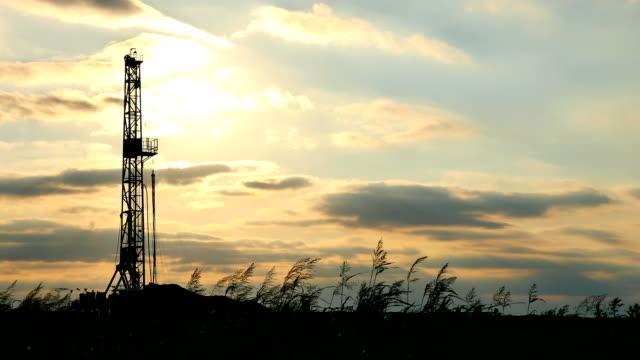 fracking backlit - fracking stock videos and b-roll footage