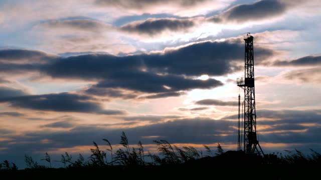 fracking blue sun - oil drill stock videos and b-roll footage
