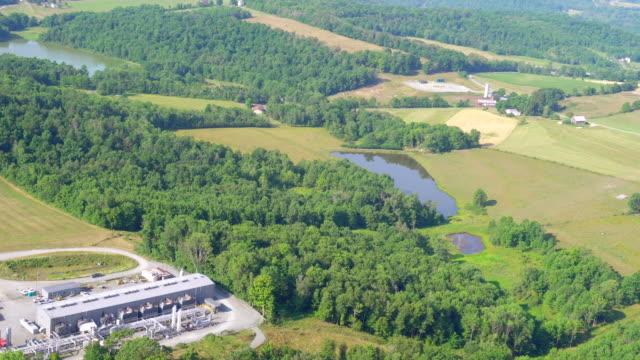 ws aerial fracking drill rig near farmland / pennsylvania, united states - fracking stock videos and b-roll footage