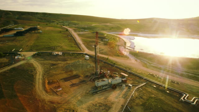 fracking drilling rig - aerial view - drill stock videos & royalty-free footage