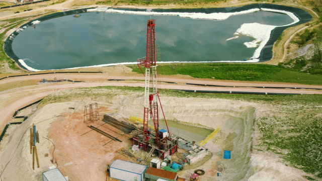 fracking drilling rig - aerial view - metal ore stock videos & royalty-free footage