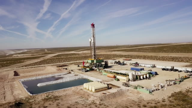 fracking drilling rig at dusk or dawn - gasoline stock videos & royalty-free footage