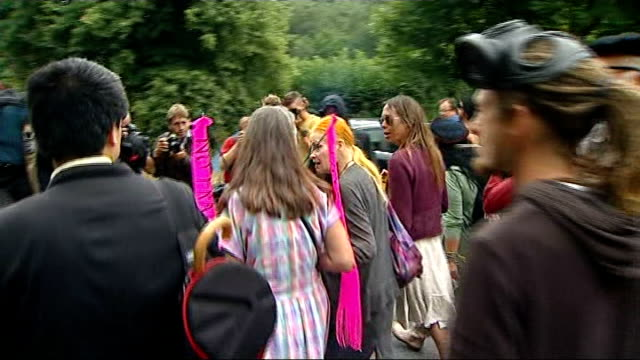 fracking operation halted on police advice; england: west sussex: balcombe: ext environmental protesters marching along road towards protest camp set... - west sussex stock videos & royalty-free footage
