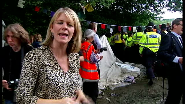 Fracking protests in Sussex / Caroline Lucas arrested ENGLAND Sussex Balcombe EXT Various shots protester with megaphone chanting 'Power to the...