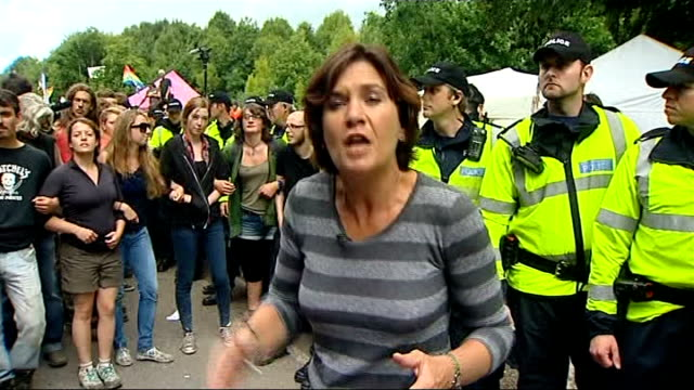 fracking protests in sussex / caroline lucas arrested england sussex balcombe ext gvs of police holding back antifracking protesters at cuadrilla... - media interview stock videos and b-roll footage