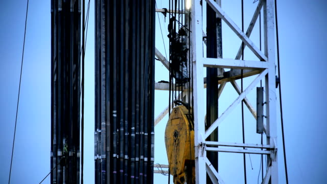Fracking Rig Climbing Worker