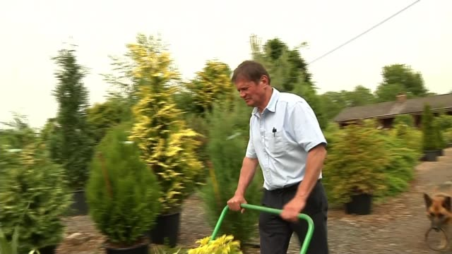 Fracking site in Lancashire given the go ahead ENGLAND Lancashire EXT Nursery owner John Tootill pushing trolley full of plants at nursery John...