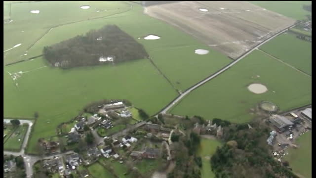fracking to continue with close monitoring; air views / aerials patchwork of fields and houses - patchwork stock videos & royalty-free footage