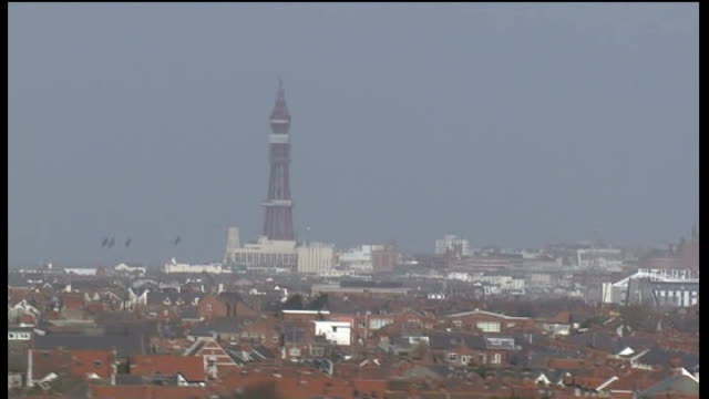 fracking to continue with close monitoring; england: lancashire: blackpool: ext air views / aerials blackpool tower with rooftops of suburban houses... - patchwork stock videos & royalty-free footage