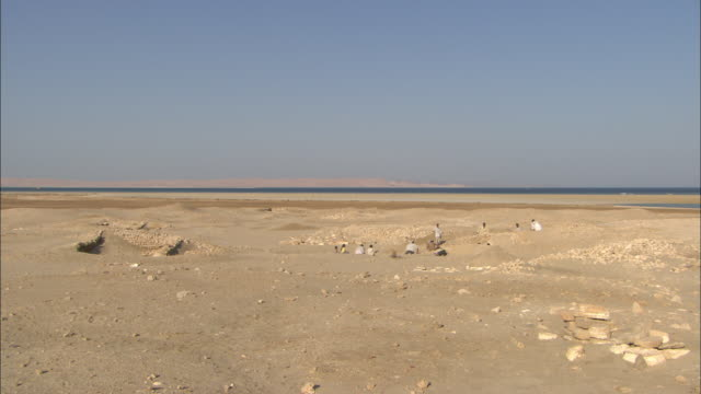 fragments of berenike litter the desert that stretches toward the red sea. - red sea stock videos & royalty-free footage