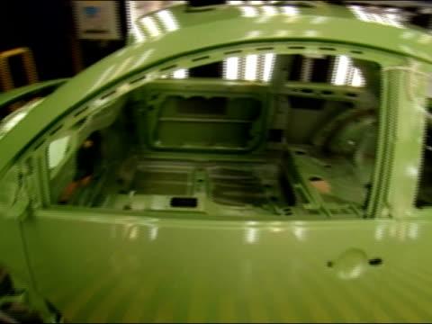 vídeos y material grabado en eventos de stock de frame of car moving along assembly line / germany - carrocería
