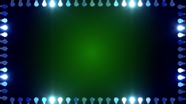 中央の青と緑のコピースペースで境界線のライトのフレーム - 照明器具点の映像素材/bロール