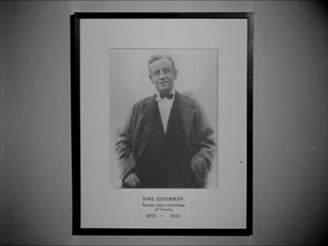 stockvideo's en b-roll-footage met framed photograph founder sime silverman 'variety' headlines 'sticks nix hick pix' 'pix tricks mix latins' 'burley back with a bump' - 1943