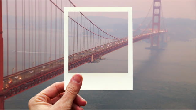 framing the golden gate bridge with instant print picture from personal perspective. - subjektive kamera blickwinkel aufnahme stock-videos und b-roll-filmmaterial