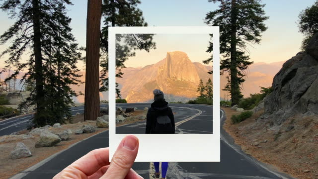 framing traveler woman from the glacier point road and half dome with instant print picture from personal perspective. - half dome stock videos & royalty-free footage