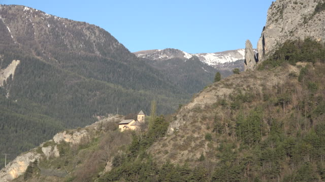 france alpine village church near barcelonette zooms in - circa 12th century stock videos and b-roll footage