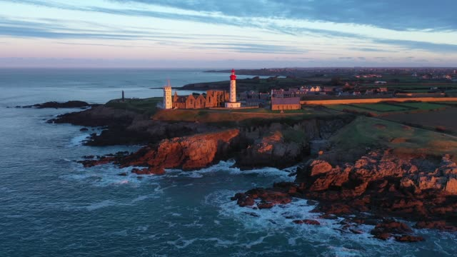 france and bretagne from the sky : first rays of light at he pointe saint-mathieu - france stock videos & royalty-free footage