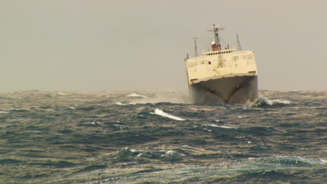"france, bretagne: ""african highway"" cargo boat tossed by waves - nave mercantile video stock e b–roll"