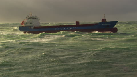 france, bretagne: cargo boat cleaving through waves - industrial sailing craft stock videos & royalty-free footage