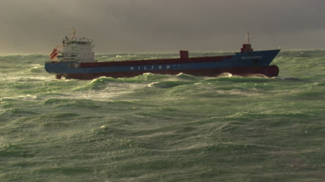 france, bretagne: cargo boat cleaving through waves - nave mercantile video stock e b–roll