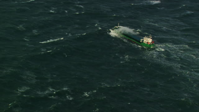 france, bretagne: cargo boat cleaving through waves - cargo ship stock videos & royalty-free footage